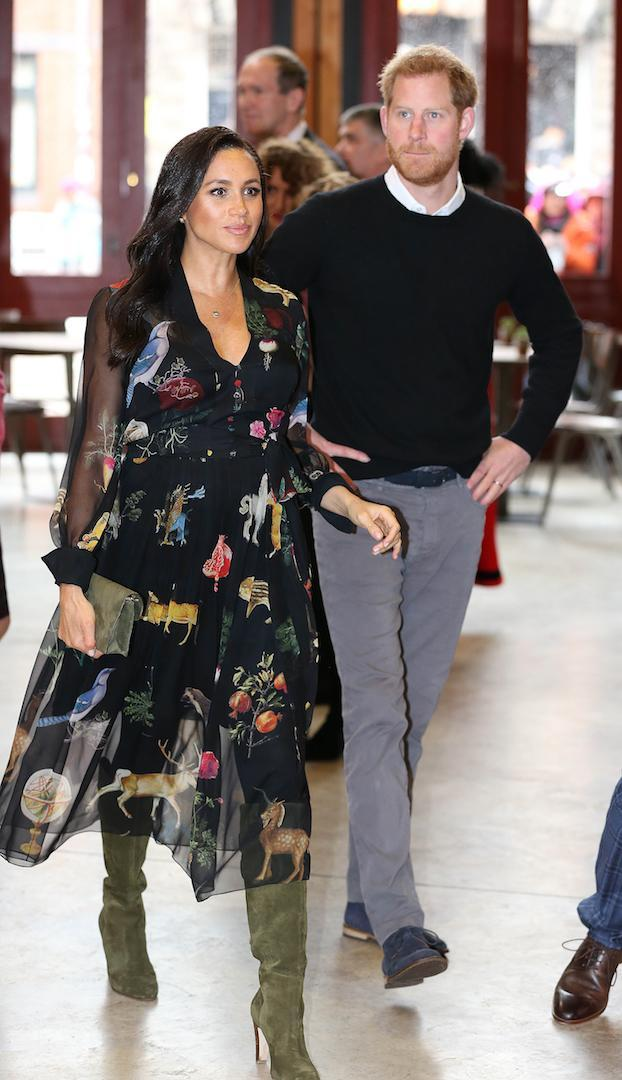 For a trip to Bristol Old Vic theatre, the pregnant royal wore a £1,400 Oscar de la Renta dress with a Ralph Lauren clutch and snow-proof Sarah Flint boots. [Photo: PA]