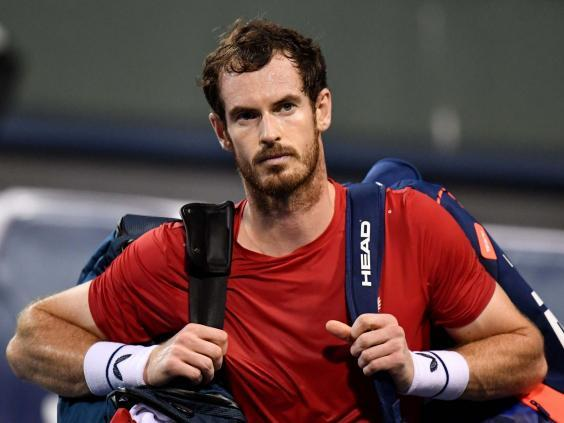 Andy Murray walks off the court in Shanghai after being defeated in the deciding tie-break (Getty)