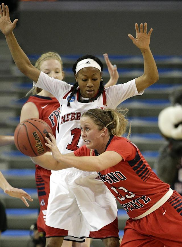 Fresno State's Taylor Thompson (33) passes the ball as she is defended by Nebraska's Tear'a Laudermill (1) during the second half of a first-round game in the NCAA women's college basketball tournament on Saturday, March 22, 2014, in Los Angeles. Nebraska won 74-55. (AP Photo/Jae C. Hong)