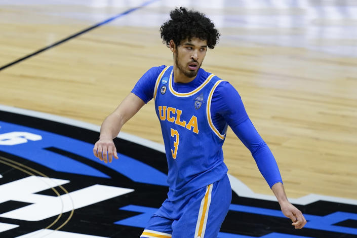 UCLA guard Johnny Juzang runs up court after making a basket during the second half of an Elite 8 game against Michigan in the NCAA men's college basketball tournament at Lucas Oil Stadium, Tuesday, March 30, 2021, in Indianapolis. (AP Photo/Darron Cummings)