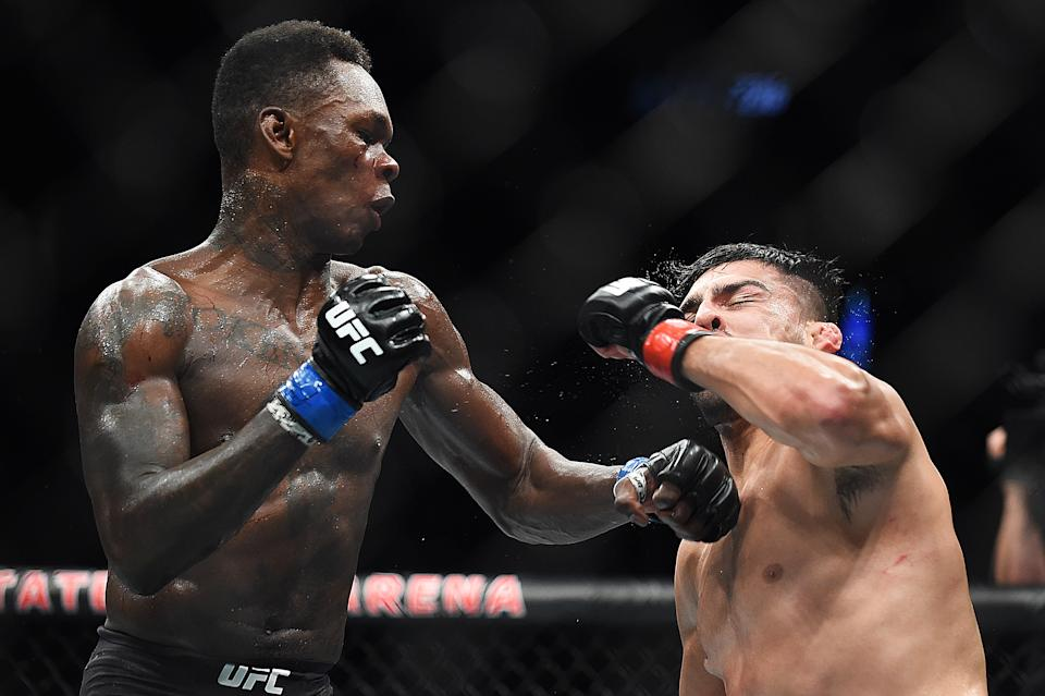 ATLANTA, GEORGIA - APRIL 13: Israel Adesanya of Nigeria punches Kelvin Gastelum during the UFC 236 event at State Farm Arena on April 13, 2019 in Atlanta, Georgia. (Photo by Logan Riely/Getty Images)