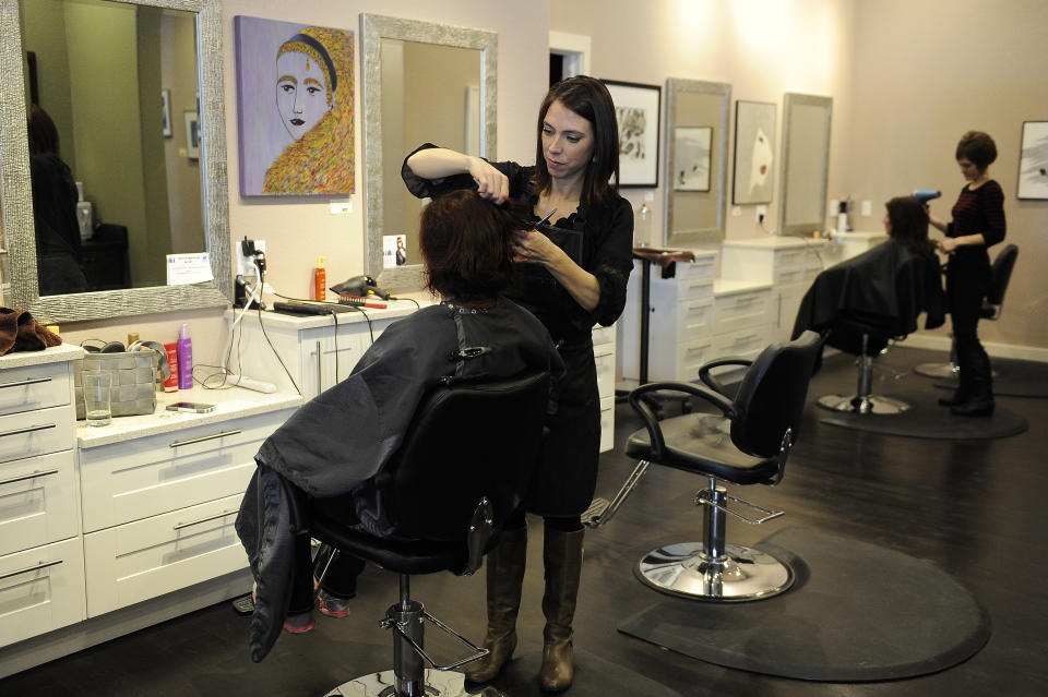 PARKER, CO - FEBRUARY 4: Karen Hockaday styles Karyn Richardson's hair at the Polished Nail Spa & Salon on February 4, 2016, in Parker, Colorado. Lori Rappucci opened the Polished Nail Spa & Salon in March 2015. (Photo by Anya Semenoff/The Denver Post via Getty Images)