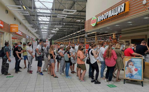 PHOTO: People line up to receive vaccine against the coronavirus disease (COVID-19) at a vaccination centre in the Globus shopping mall in Vladimir, Russia, July 15, 2021. (Polina Nikolskaya/Reuters)