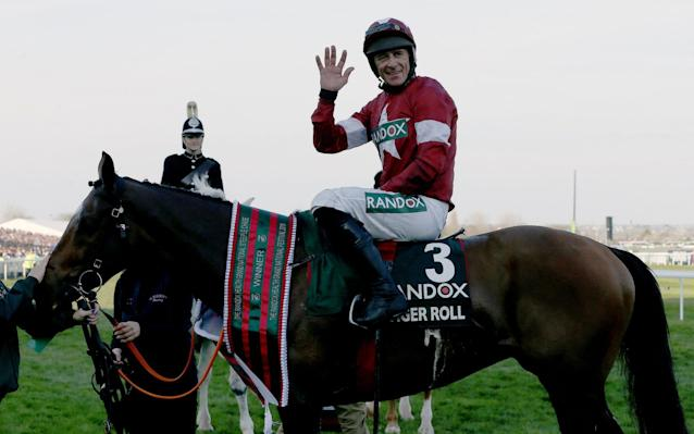 Tiger Roll, ridden here by Davy Russell, is among the winners of this race - but it has attracted concern - REX