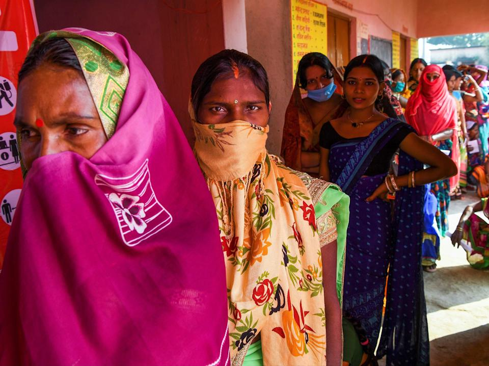 Voters queue up to cast their ballots for Bihar state assembly elections at a polling station (AFP via Getty Images)