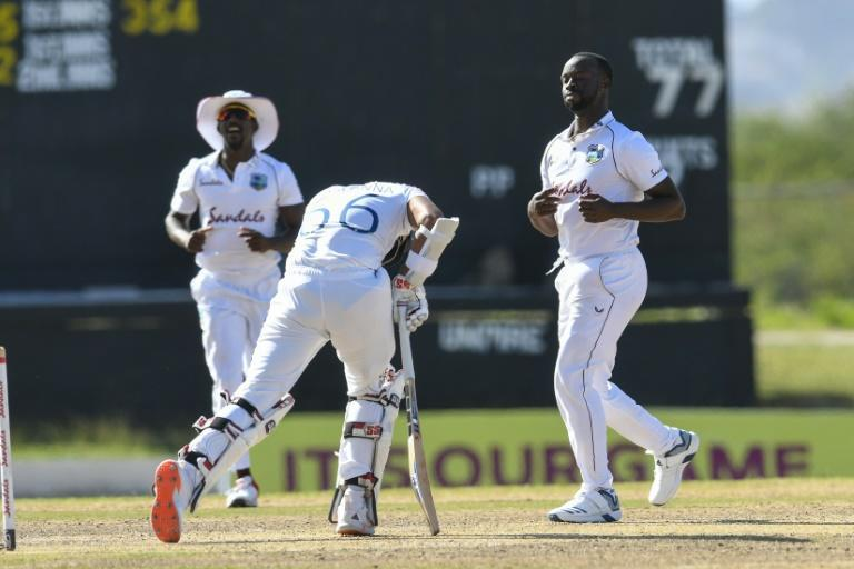 West Indies fast bowler Kemar Roach (R) took 8-40 to bowl Surrey to victory over Hampshire