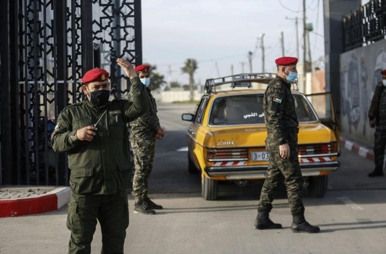 Palestinian security forces loyal to Hamas stand guard at the Rafah border crossing with Egypt