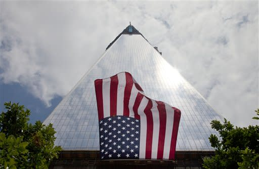 An American flag, draped on the side of One World Trade Center, flaps in the wind, Thursday, June 14, 2012 in New York. President Barack Obama is scheduled to visit the site later Thursday. (AP Photo/Mark Lennihan)