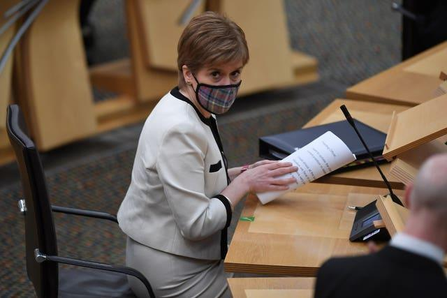 First Minister Nicola Sturgeon, wearing a face mask, ahead of a statement on new COVID-19 restrictions at the Scottish Parliament in Holyrood, Edinburgh. Among the stricter rules announced by the First Minister are a ban on drinking alcohol outdoors in public areas under lockdown and further restrictions on takeaways and click and collect services