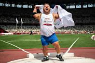 Russian Paralympic Committee's Denis Gnezdilov celebrates after winning gold in the men's shot put F40 final at the Tokyo Paralympic Games (AFP/Philip FONG)