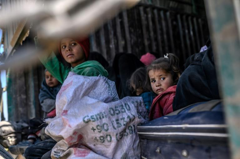 """The women and children who have escaped the last IS redoubt have been """"very hungry and dirty"""", aid workers say"""