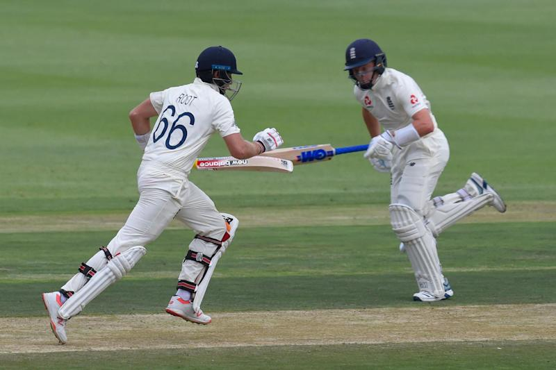 Steadying the ship: Joe Root and Ollie Pope (AFP via Getty Images)