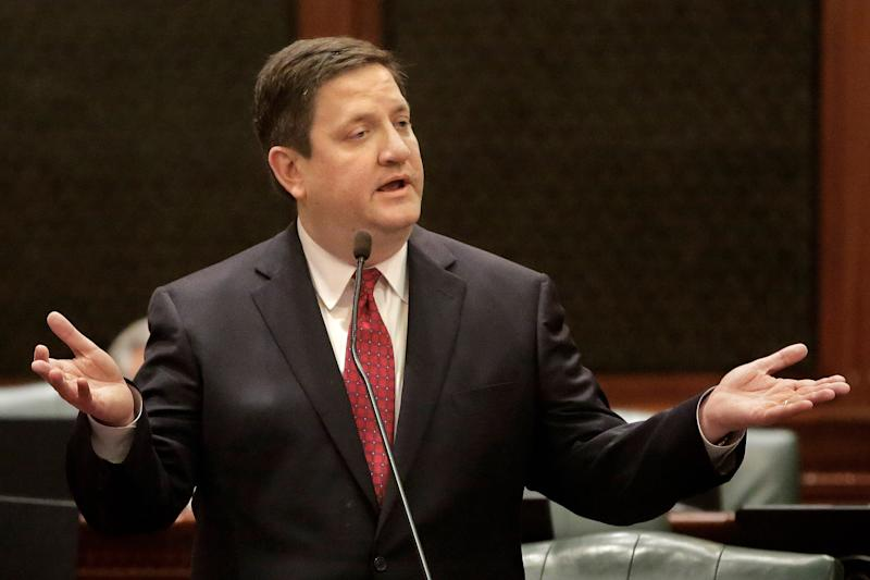 Illinois Rep. David McSweeney, R-Cary, argues pension legislation while on the House floor at the Illinois State Capitol Tuesday, Dec. 3, 2013 in Springfield Ill. (AP Photo/Seth Perlman)