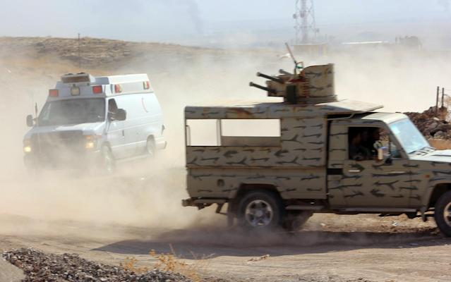 Fighting in a village in the Nawaran area northeast ofMosul. (Photo: Ash Gallagher for Yahoo News)