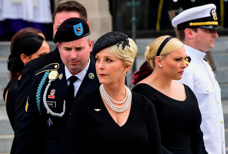 Megyn Mccain confronts Sarah Sanders over Trump's attacks on her father and vets (AFP via Getty Images)