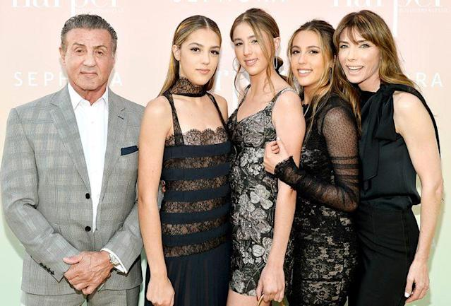 Sylvester Stallone and his ladies — Sistine Stallone, Scarlet Stallone, Sophia Stallone, and Jennifer Flavin — celebrating the girls' <em>Harper's Bazaar</em> cover on April 26. (Photo: Stefanie Keenan/Getty Images for Harper's Bazaar)