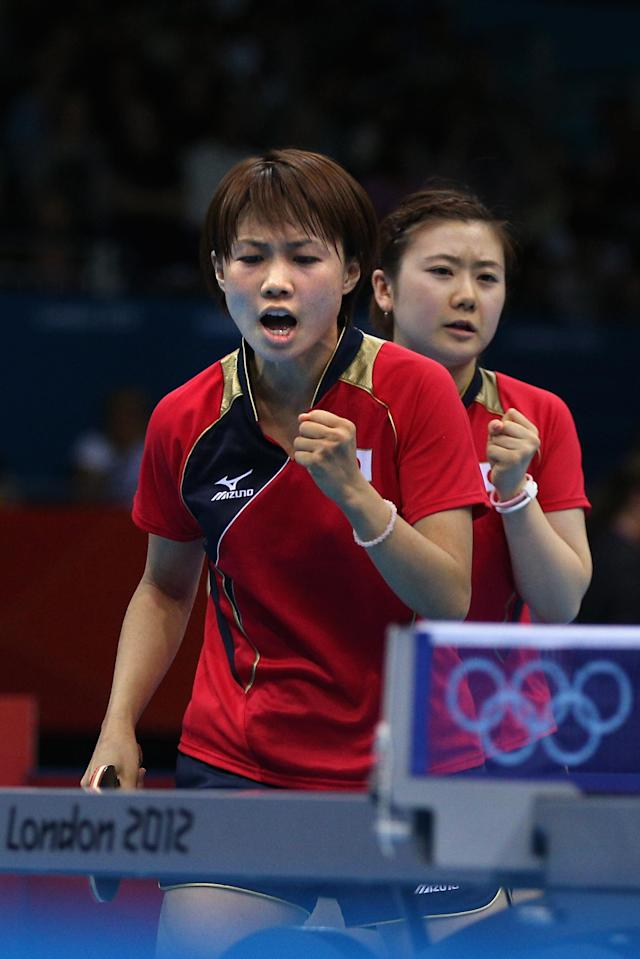 LONDON, ENGLAND - AUGUST 04: Ai Fukuhara and Sayaka Hirano of Japan celebrate during Women's Team Table Tennis quarterfinal match against team of Germany on Day 8 of the London 2012 Olympic Games at ExCeL on August 4, 2012 in London, England. (Photo by Feng Li/Getty Images)