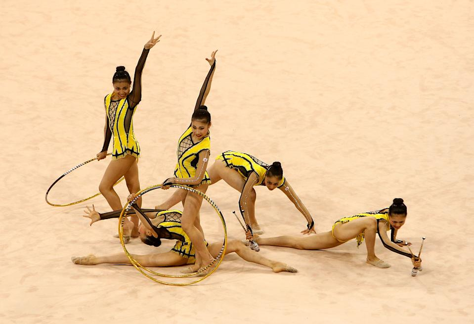 BEIJING - AUGUST 22: Team Japan competes in the Group All-Around Qualification round of the Rhythmic Gymnastics event at the Beijing University of Technology Gymnasium on Day 14 of the Beijing 2008 Olympic Games on August 22, 2008 in Beijing, China. (Photo by Vladimir Rys/Bongarts/Getty Images)