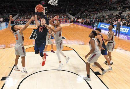 Mar 24, 2019; San Jose, CA, USA; Liberty Flames forward Scottie James (31) shoots against Virginia Tech Hokies guard Wabissa Bede (3) during the first half in the second round of the 2019 NCAA Tournament at SAP Center. Mandatory Credit: Kyle Terada-USA TODAY Sports