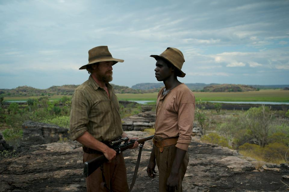 """An aboriginal man (Jacob Junior Nayinggul, right) teams up with a former sniper (Simon Baker) to find his uncle, who also happens to be the most dangerous warrior in the outback, in """"High Ground."""""""