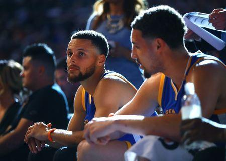 Apr 5, 2017; Phoenix, AZ, USA; Golden State Warriors guard Stephen Curry (left) and guard Klay Thompson on the bench against the Phoenix Suns in the second quarter at Talking Stick Resort Arena. Mandatory Credit: Mark J. Rebilas-USA TODAY Sports