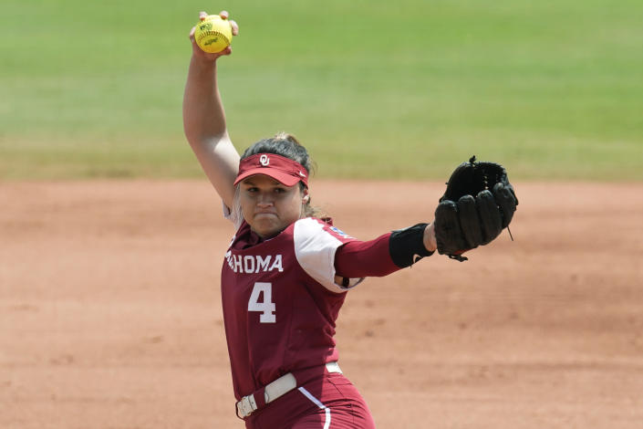 Oklahoma's Shannon Saile pitches in the first inning of an NCAA Women's College World Series softball game against James Madison, Sunday, June 6, 2021, in Oklahoma City. (AP Photo/Sue Ogrocki)