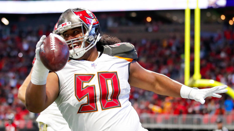 Vita Vea of the Tampa Bay Buccaneers reacts after making a touchdown reception during the first half of an NFL game against the Atlanta Falcons in Atlanta, Georgia. (Photo by Todd Kirkland/Getty Images)