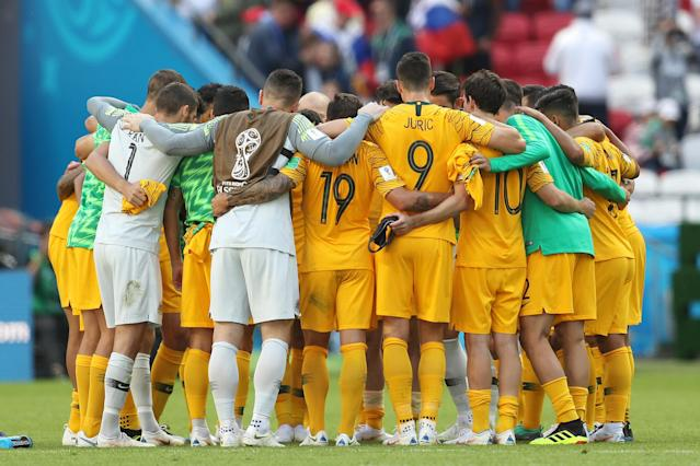 <p>Australia come together minutes after their first game ended in defeat </p>