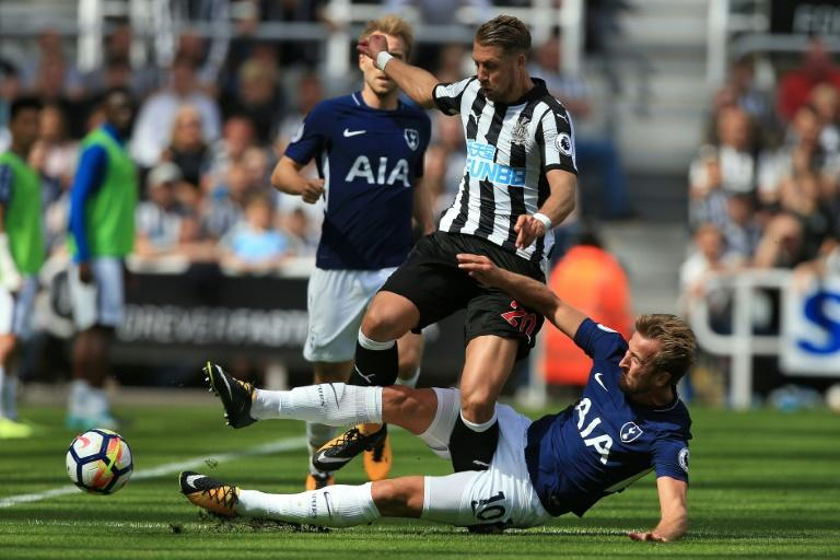 Tottenham Hotspur's striker Harry Kane (R) slides to tackle Newcastle United's midfiielder Florian Lejeune during the English Premier League football match August 13, 2017