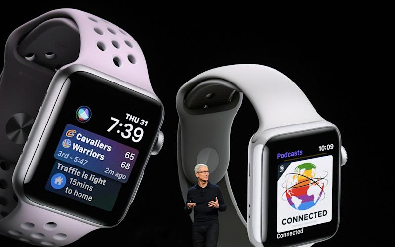 Tim Cook showing off the Apple Watch 3 - Bloomberg