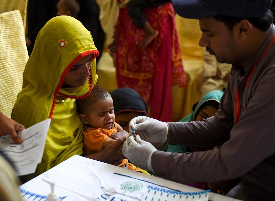 Pakistani paramedics have been taking blood samples for HIV testing in the city of Rato Dero (AFP Photo/RIZWAN TABASSUM)