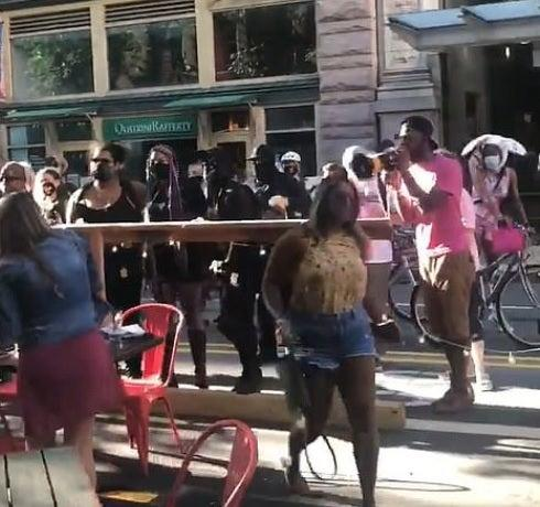 Protesters confront diners in Pittsburgh (Facebook)