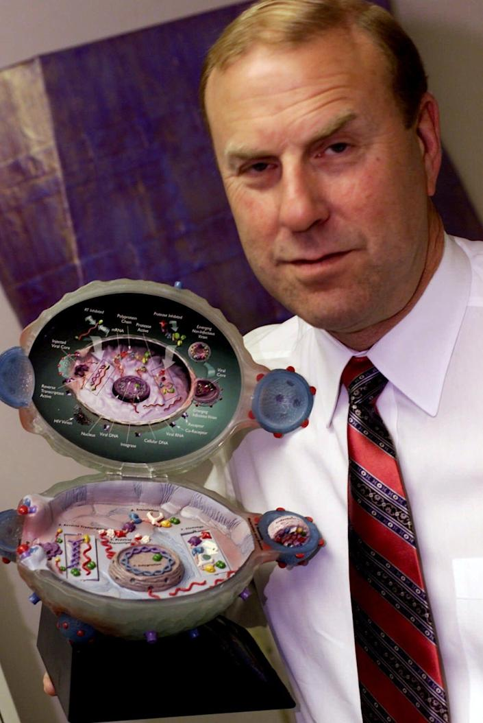 Dr. Michael Gottlieb displays a model of an HIV-infected cell during an interview Friday, June 1, 2001, at the Synergy Hematology-Oncology Medical Associates, Inc. office in Los Angeles. Gottlieb published a brief note in a weekly report put out by the Centers for Disease Control on June 5, 1981, noting the odd cases of five homosexual men who had contracted a form of pneumonia normally found only in those with severely weakened immune systems. The report, largely ignored, was the first official notice of what is now recognized as AIDS.