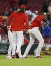 Cincinnati Reds players douse teammate Aristides Aquino, right, after his RBI single in the 11th inning against Washington Nationals pitcher Mason Thompson to win a baseball game in Cincinnati, Ohio, Friday, Sept. 24, 2021. (AP Photo/Paul Vernon)