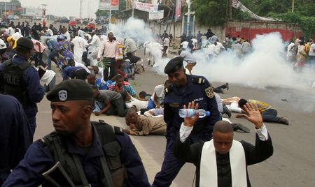 FILE PHOTO: Riot policemen fire tear gas to disperse Catholic priest and demonstrators during a protest against President Joseph Kabila, organized by the Catholic church in Kinshasa, Democratic Republic of Congo January 21, 2018. REUTERS/Kenny Katombe