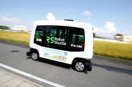 Robot Shuttle, a driver-less, self driving bus, developed by Japan's internet commerce and mobile games provider DeNA Co., drives past during an experimental trial with a self-driving bus in a community in Nishikata town, Tochigi Prefecture, Japan September 8, 2017. REUTERS/Issei Kato