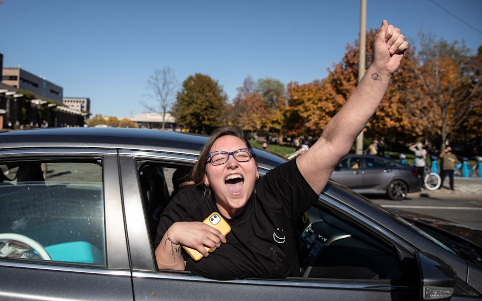 People celebrate from their cars outside Independence Mall in Philadelphia on Nov. 7. (Photo: Chris McGrath/Getty Images)