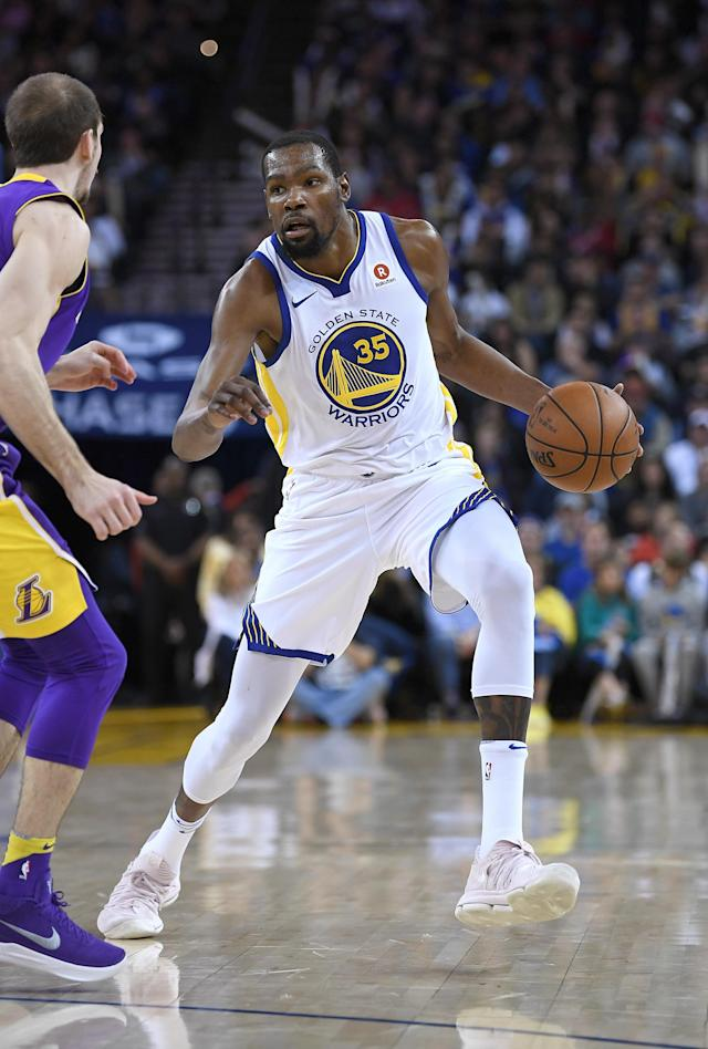OAKLAND, CA - MARCH 14: Kevin Durant #35 of the Golden State Warriors dribbles the ball while guarded closely by Alex Caruso #4 of the Los Angeles Lakers during an NBA basketball game at ORACLE Arena on March 14, 2018 in Oakland, California. (Photo by Thearon W. Henderson/Getty Images)