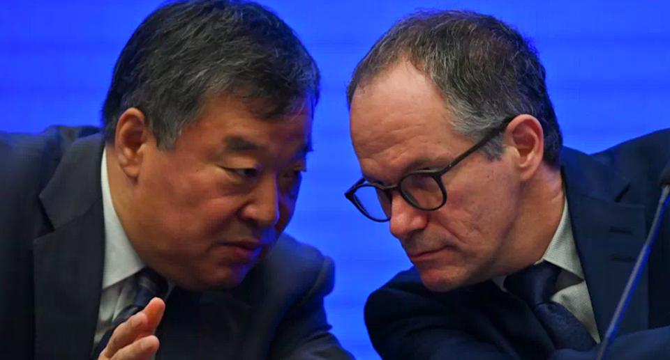 Peter Ben Embarek talks with Liang Wannian (left) during a press conference at the end of the WHO-led mission in China. Source: Getty