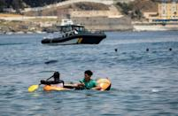 Some arrived by swimming or by walking at low tide, others used rubber dinghies