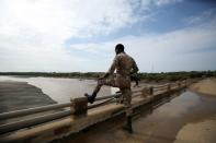 Member of the Amhara Special Forces stands guard on the Tekeze river bridge near Ethiopia-Eritrean border