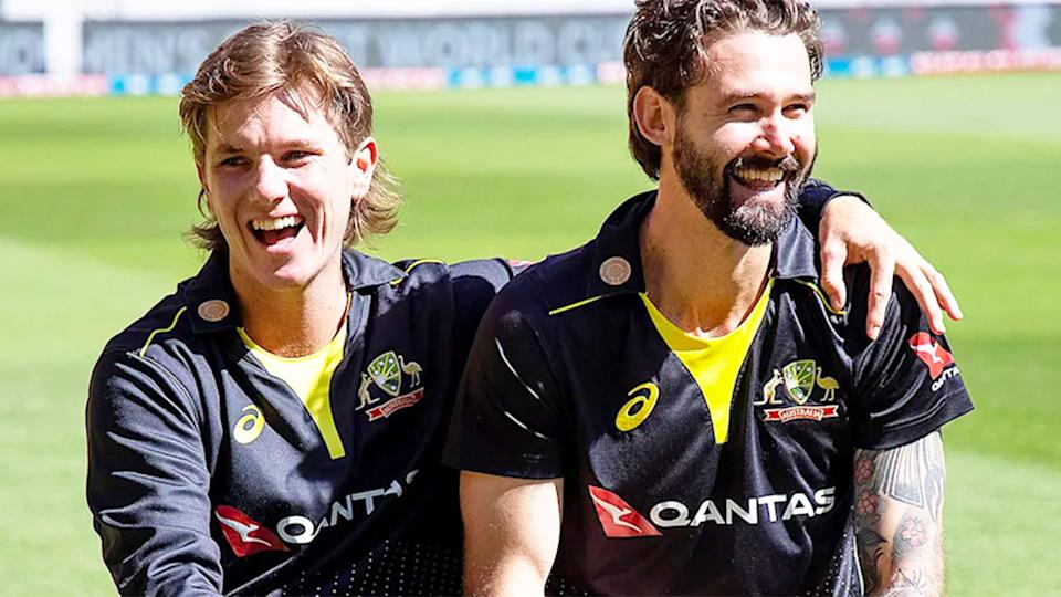 Pictured here, Adam Zampa and Kane Richardson share a laugh after posing for a photo.