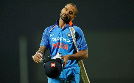 Cricket - Sri Lanka v India - Third One Day International Match - Pallekele, Sri Lanka - August 27, 2017 - India's Shikhar Dhawan reacts as he walks off the field after his dismissal by Sri Lanka's Lasith Malinga. REUTERS/Dinuka Liyanawatte