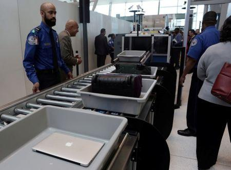 FILE PHOTO: Baggage and a laptop are scanned using the Transport Security Administration's new Automated Screening Lane technology at Terminal 4 of JFK airport in New York City