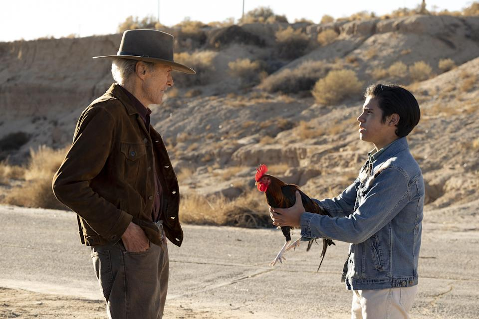 """Mike (Clint Eastwood, left) is an old rodeo star and horse breeder who befriends a boy (Eduardo Minett) and his rooster in the Western drama """"Cry Macho."""""""