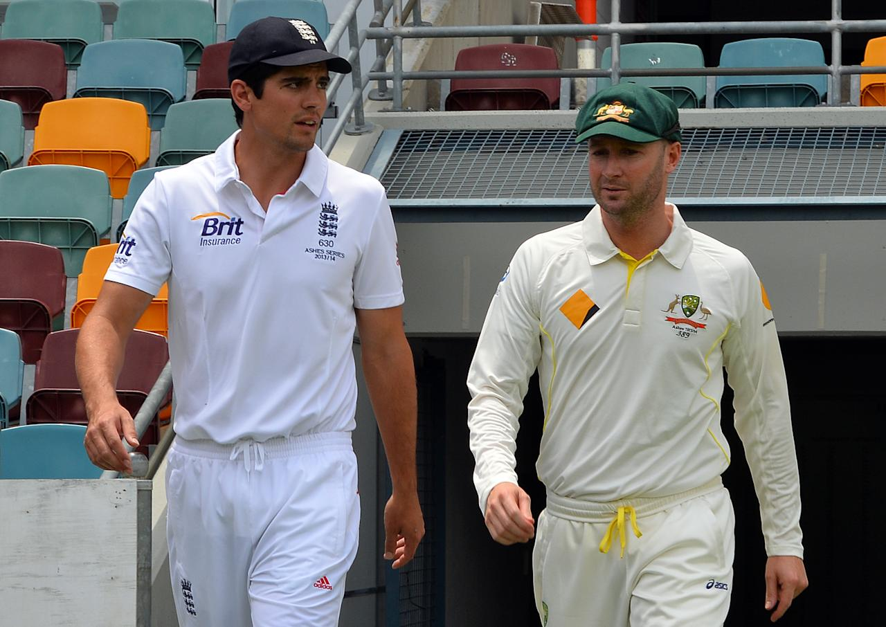 England Captain Alistair Cook (L) and Australian Captain Michael Clarke walk onto the grounds following a photo call at the Gabba in Brisbane on November 20, 2013, on the eve of the first Ashes cricket test match between England and Australia.   IMAGE RESTRICTED TO EDITORIAL USE - STRICTLY NO COMMERCIAL USE AFP PHOTO / Saeed KHAN        (Photo credit should read SAEED KHAN/AFP/Getty Images)