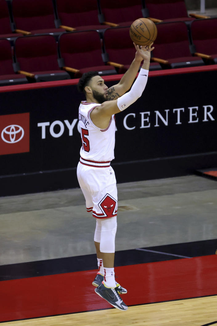 Chicago Bulls' Denzel Valentine shoots a basket against the Houston Rockets during the second quarter of an NBA basketball game Monday, Feb. 22, 2021, in Houston. (Carmen Mandato/Pool Photo via AP)