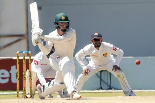 Zimbabwe captain Sean Williams reverse sweeps on his way to 39