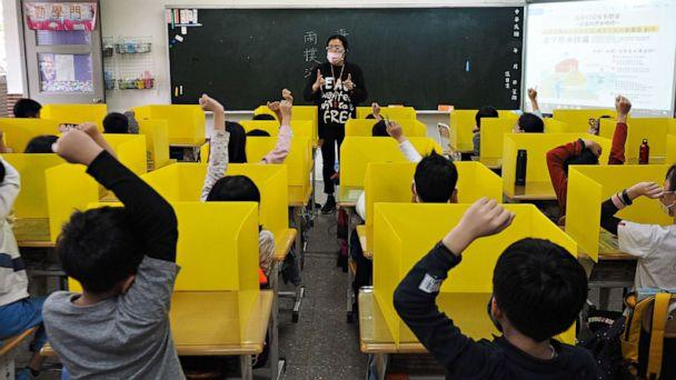 PHOTO: Pupils sit behind partitions during a class taught by Chen Ting-fang at Dajia Elementary School in Taipei, Taiwan, March 3, 2020. The school prepared the partitions as a way to prevent the spread of illnesses during the COVID-19 outbreak. (David Chang/epa-efe/rex/David Chang/EPA via Shutterstock)
