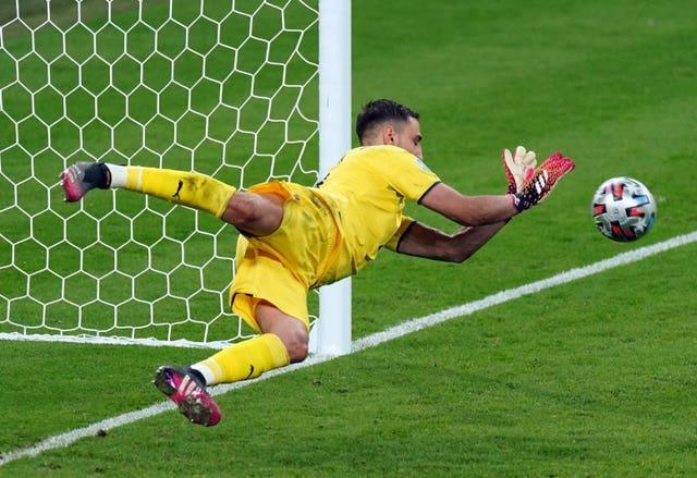 Donnarumma saved two penalties as Italy beat England in Sunday's shootout (Mike Egerton/PA).